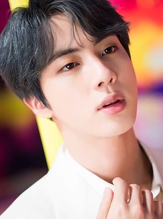 This image has an empty alt attribute; its file name is 330px-jin_for_dispatch__boy_with_luv__mv_behind_the_scene_shooting_15_march_2019_01_cropped-1.jpg